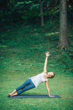 Girl doing  side plank pose
