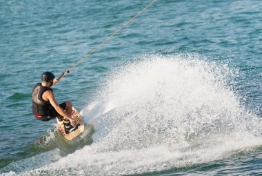 Man riding wakeboard at high speed
