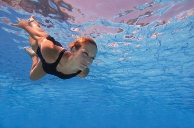 female swimming underwater
