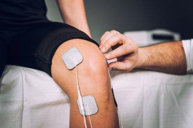 Electro stimulation used to treat knee pain