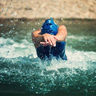 female triathlete in water