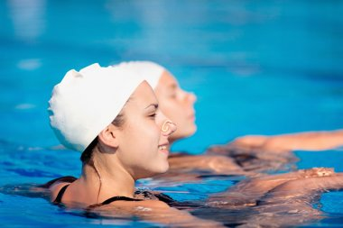 swimmers duet in swimming pool