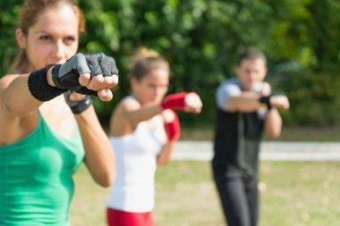 Tae Bo team training in park