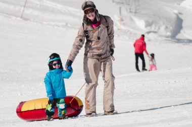 woman and boy ready for snowtubing