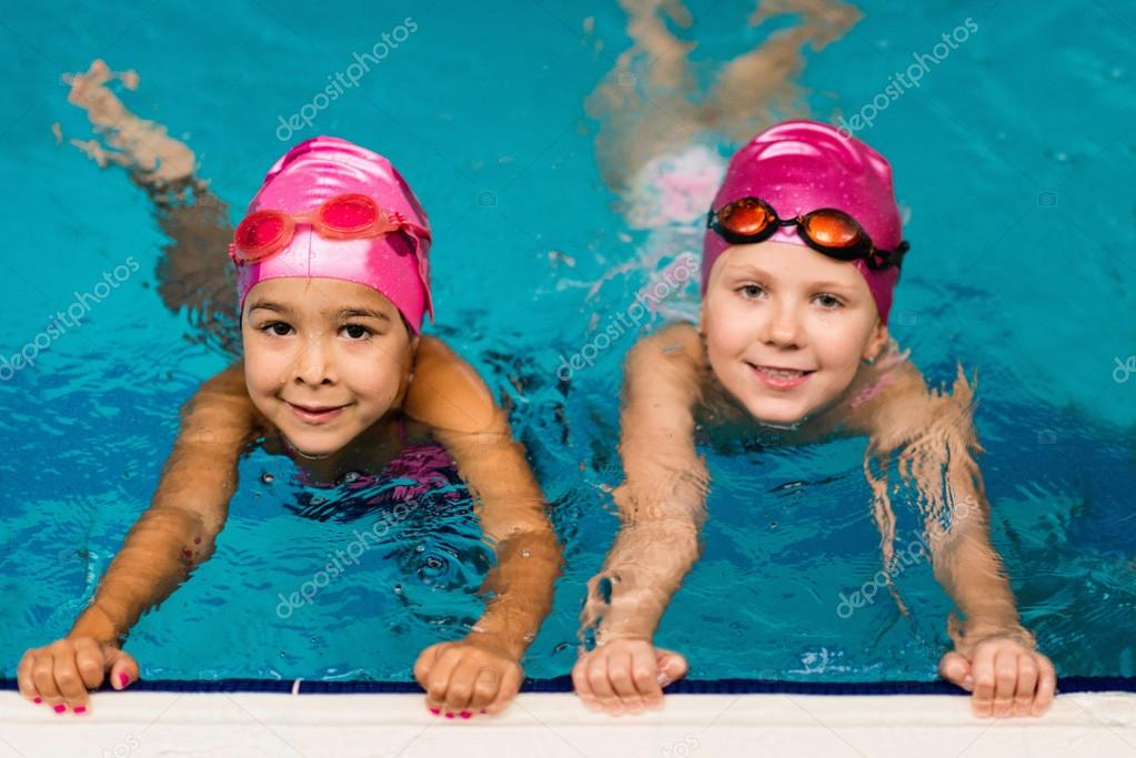 Two little girls in swimming pool