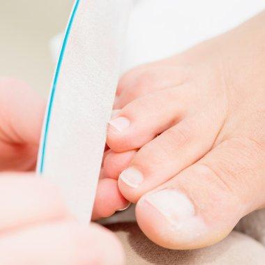 Nail filing on pedicure treatment