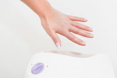Hand treatment in paraffin bath