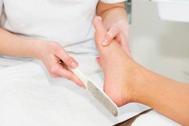 scrubbing heel Pedicure