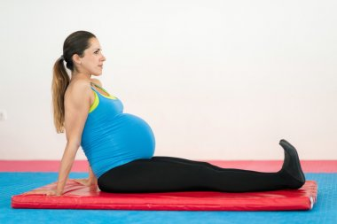 pregnant lady doing simple exercises