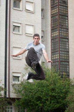 Parkour runner jumping high