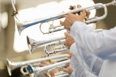 Trumpet players with musical instruments