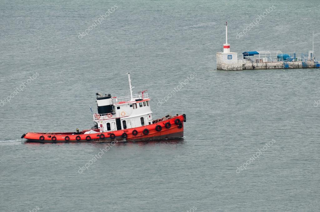 Tugboat at port entrance