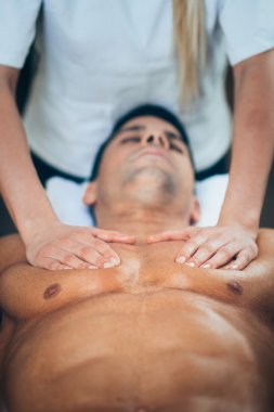Physical therapist doing massage of chest