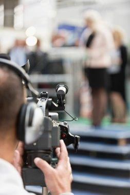 Cameraman recording press conference