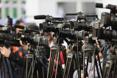 Row of TV cameras lined up, covering public event stock vector
