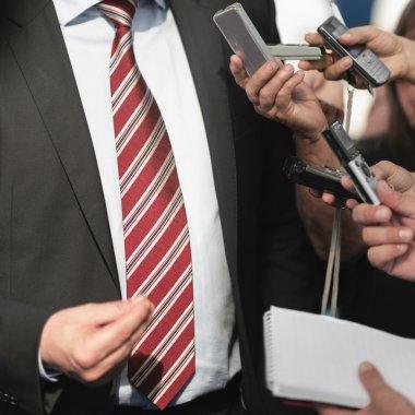 journalists interviewing politician