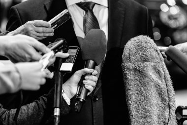 group of journalists surrounding politician