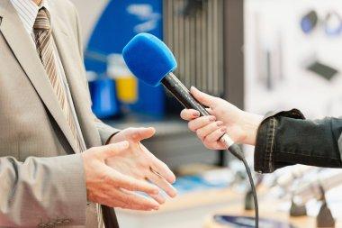 TV reporter interviewing businessman