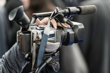 journalist with Camera at conference