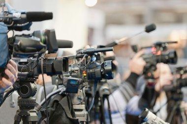 Press conference cameras