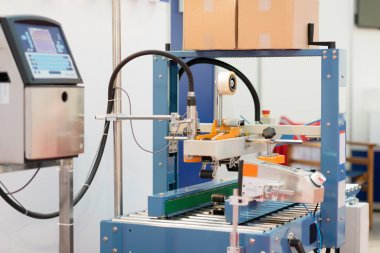 Carton sealing machine working stock vector