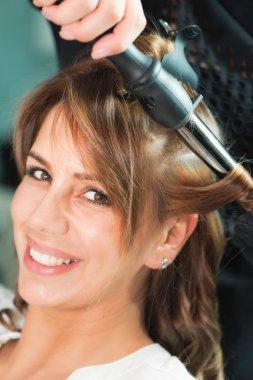 Curling hair in beauty salon
