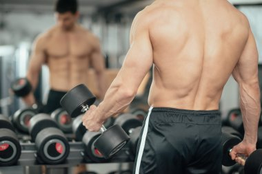 man working out with weights in gym