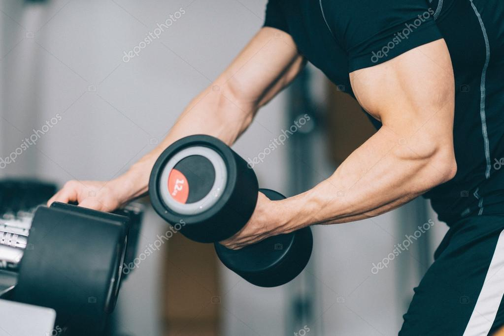 Muscular young man in gym