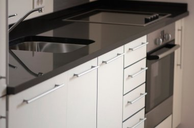 Cabinet and stove in modern kitchen