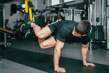 Male athlete at TRX Suspension Training