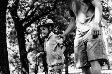 Boy learning roller skating in park