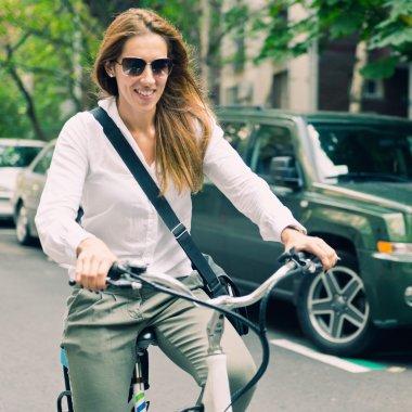 Young woman using E-bike