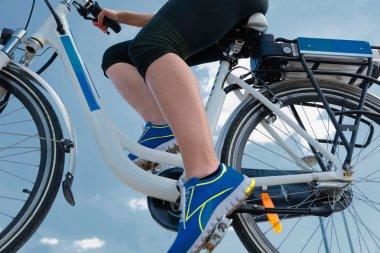 female Riding e-bike