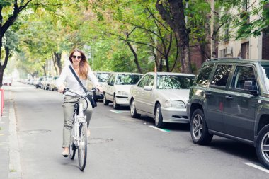Woman riding electric bicycle