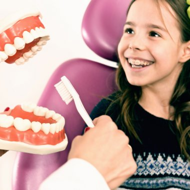 girl at dentist learning about hygiene