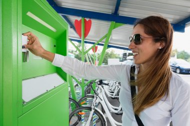woman using bicycle sharing system