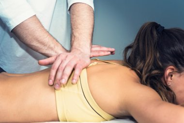 therapist massaging female patient