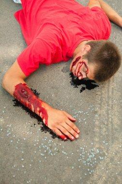 Victim of traffic accident lying on street