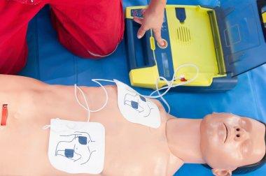 Paramedic activating portable defibrillator