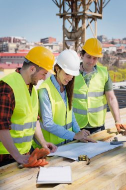 female Architect cooperating with construction workers