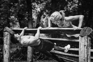 Muscular crossfit couple exercising