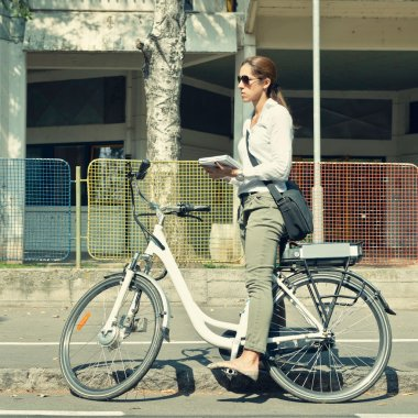 woman with electric bicycle