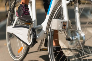 leg on Electric bicycle pedal