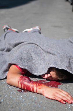 Dead body covered with blanket