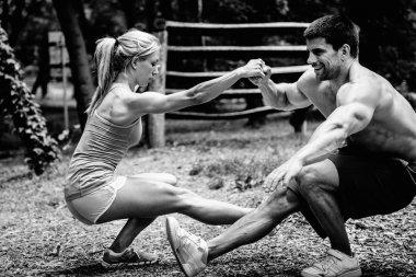Crossfit couple doing pistol squats