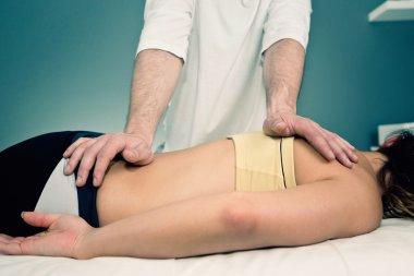 Chiropractor working with patient