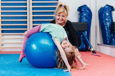 Physical therapist working with girl