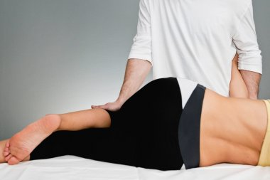 Chiropractic examining female patient