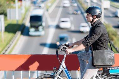 male Commuter riding e-bike