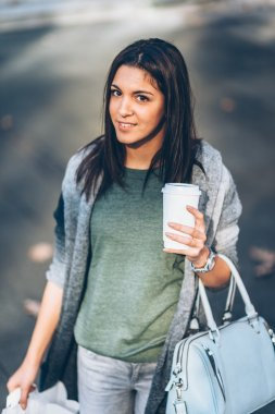 Girl with take-away coffe